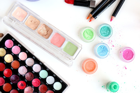 Picture of different-colored cosmetic powders with other cosmetic accessories Stock Photo - 23006680
