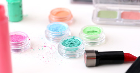 Picture of different-colored cosmetic powders with other cosmetic accessories Stock Photo - 23006782