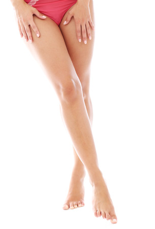 Photo of slim woman legs over a white background photo