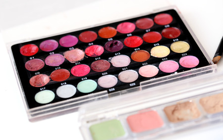 Picture of different-colored cosmetic powders with other cosmetic accessories Stock Photo - 23006911
