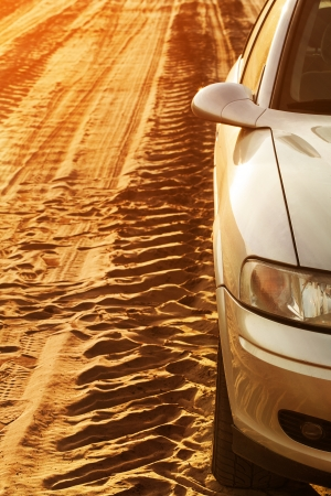 Deep trace of wheels and car on a sandy road   photo