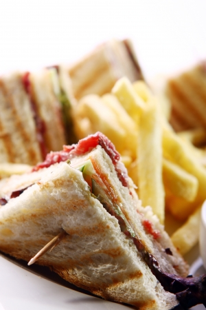 Club sandwich with salami and green photo
