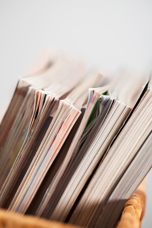 pleated: Closeup image of magazines in a straw pleated  box