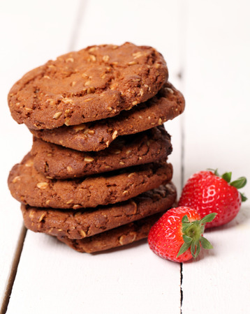 Tower from homemade tasty oatmeal cookies and strawberries photo