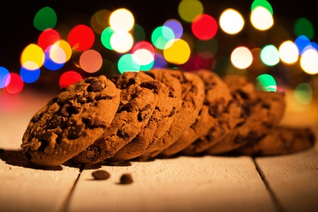 Pile of cookies. Colorful lights in the background. Smells like Christmas! photo