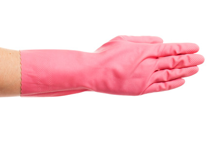 gloving up: Hand in a pink glove on a white background