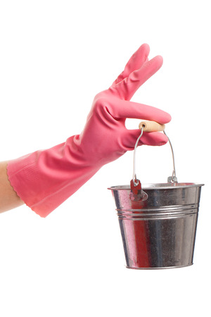 gloving up: Hand in a pink domestic glove holding silver pail isolated over white background