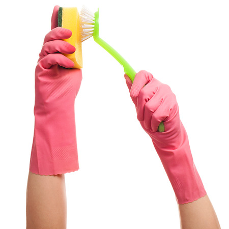 gloving up: Hands in a pink gloves holding sponge and brush isolated over white background