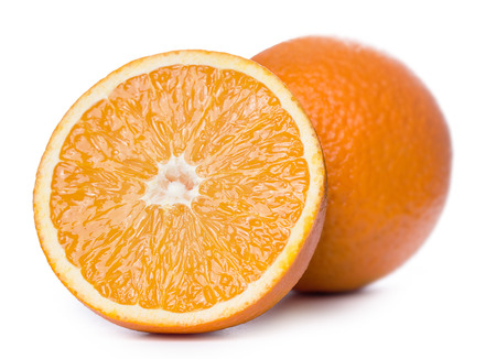Some sliced and whole oranges together over a white background photo