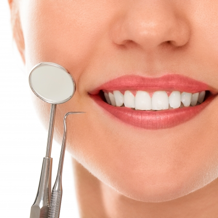 dental tools: A woman is smiling while being at the dentist Stock Photo