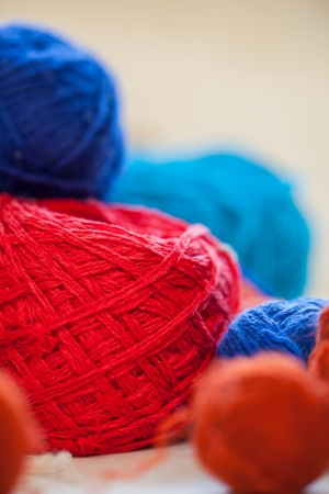 Closeup image of colorful knitting thread balls on a table photo