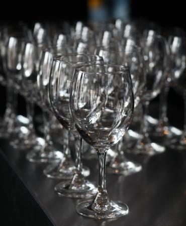 stemware: Closeup image of empty stemware standing on a black table