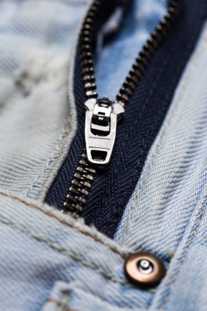 Closeup picture of a jeans zipper photo