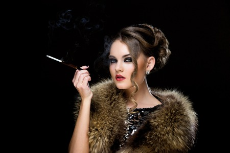 Retro  Attractive woman with cigarette photo