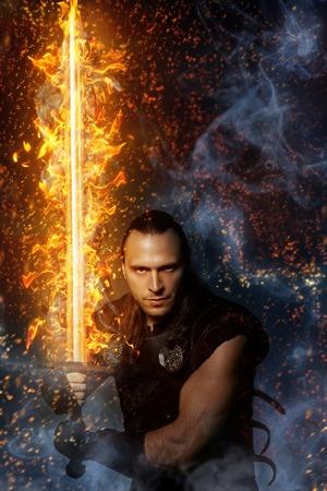 コスプレ、魔法の火の剣を持ったローン戦士 写真素材