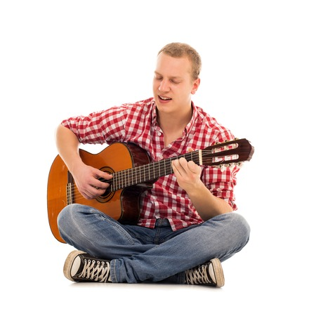 Young musician with wooden guitar photo