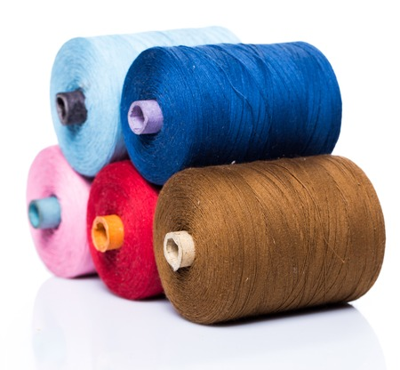 Many colorful threads on white  Stock Photo