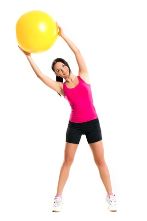 Beautiful brunette with a ball Stock Photo - 25870201