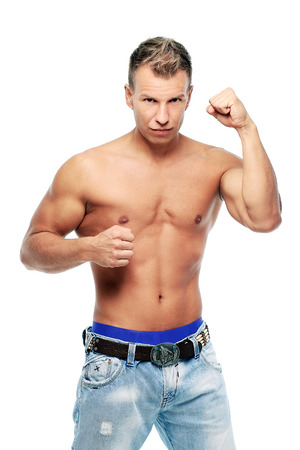 Grown man without shirt posing in studio photo