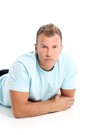 Grown man with a shirt posing in studio photo