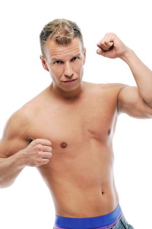 Grown man without shirt posing in studio photo
