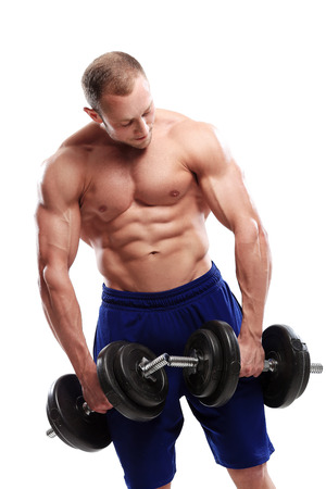 Fitness  Powerful guy with a dumbbell photo