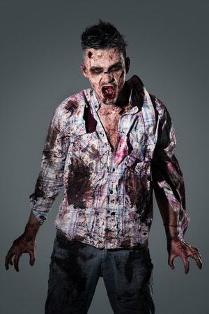 creepy hand: Aggressive, creepy zombie in clothes Stock Photo