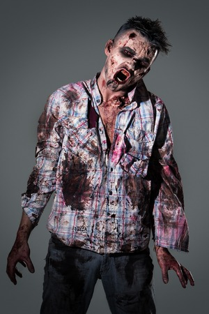 zombie: Aggressive, creepy zombie in clothes Stock Photo