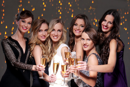 Girls with a glass of champagne meet new year photo