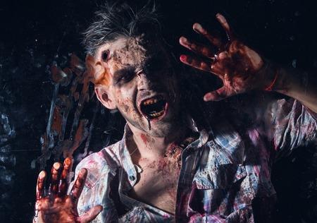 Creepy zombie behind the window photo