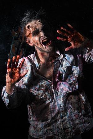 rotten teeth: Creepy zombie behind the window Stock Photo