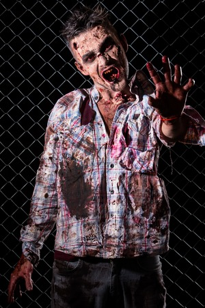 Creepy zombie on the fence background photo