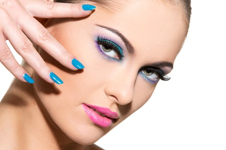Cute, attractive woman with colorful makeup photo