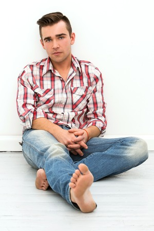 sitting on the ground: Attractive man on the floor