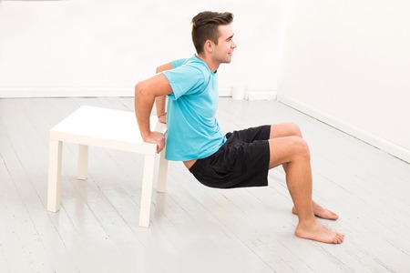 Sport  Guy doing exercise with stool Stock Photo