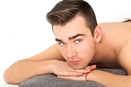 Attractive guy in spa salon photo