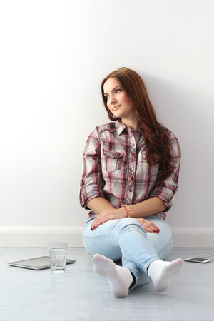 Girl on the floor with glass of water photo