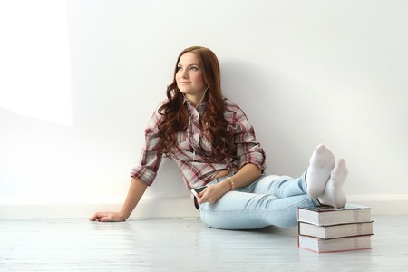 Girl on the floor with books photo