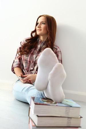 girl socks: Girl on the floor with books