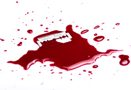 razor blade:   Red blood on white background Stock Photo