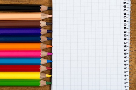 Workplace  Notepad and colorful pencils photo