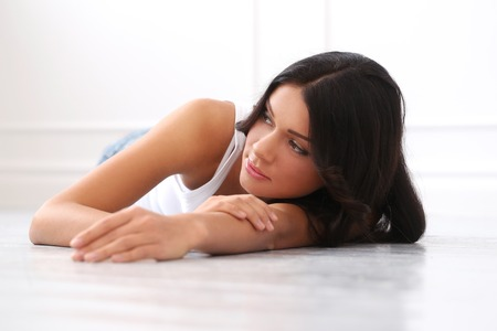 Cute, attractive woman on the floor photo