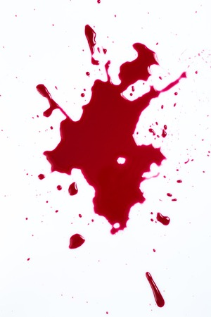 carnage:   Red blood on white background Stock Photo
