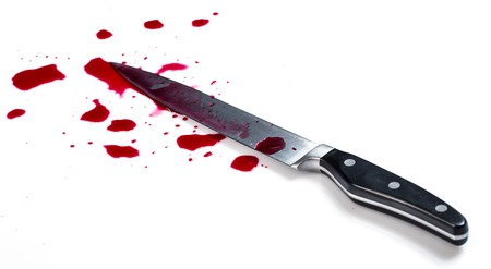Knife in pool of blood Stock Photo