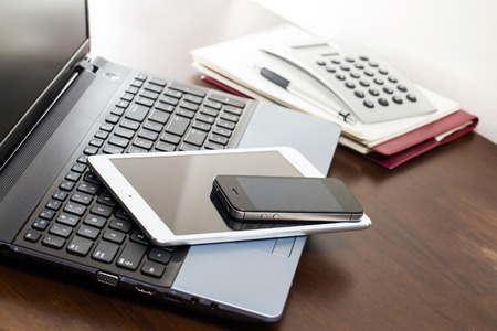 Electronic devices on the table photo
