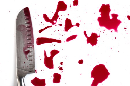 carnage: Murder  Knife in pool of blood Stock Photo