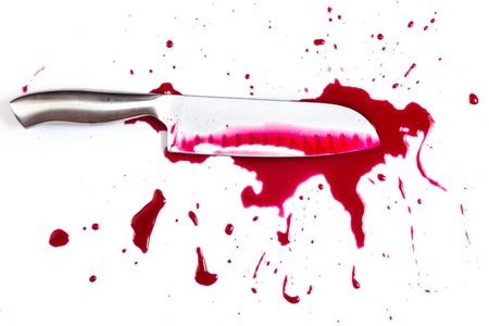 die cut:   Knife in pool of blood Stock Photo