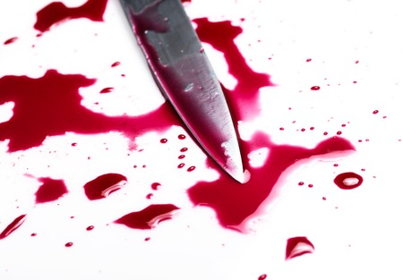 carnage:   Knife in pool of blood Stock Photo