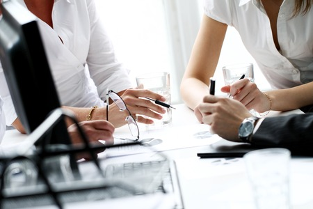 Businesspeople during conversation Stock Photo