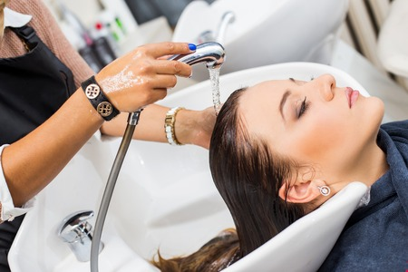 Hairdresser salon  Woman during hair wash photo